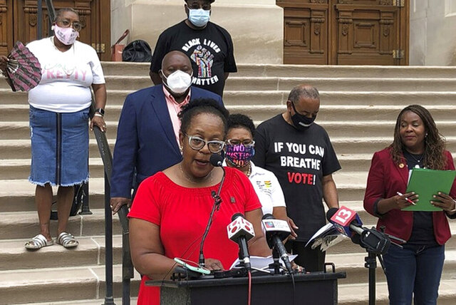 State Rep. Carolyn Jackson, D-Hammond, speaks during an Indiana Black Legislative Caucus news conference, Thursday, Aug. 13, 2020, outside the Statehouse in Indianapolis. Caucus members called for state lawmakers to increase accountability and transparency for police officers as part of a wide-ranging package of criminal justice reform proposals that they plan to push during next year's legislative session. (AP Photo/Tom Davies)