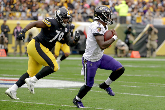 Baltimore Ravens quarterback Lamar Jackson (8) scrambles away from Pittsburgh Steelers nose tackle Javon Hargrave (79) in the first half of an NFL football game, Sunday, Oct. 6, 2019, in Pittsburgh. (AP Photo/Don Wright)