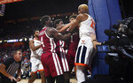Virginia's Mamadi Diakite, right, and Massachusetts players Keon Clergeot, left, Massachusetts' Samba Diallo, second from left, and Sy Chatman scuffle for the ball out of play during the second half of an NCAA college basketball game, Saturday, Nov. 23, 2019, in Uncasville, Conn. (AP Photo/Jessica Hill)