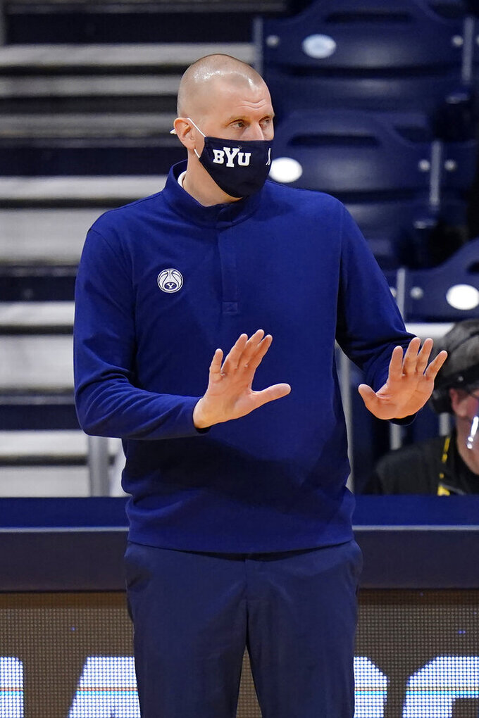 BYU head coach Mark Pope directs his team during the first half of a first-round game against UCLA in the NCAA college basketball tournament at Hinkle Fieldhouse in Indianapolis, Saturday, March 20, 2021. (AP Photo/AJ Mast)