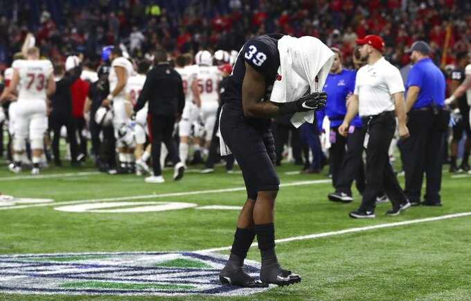 Buffalo cornerback Cameron Lewis (39) walks off the field after the Mid-American Conference championship NCAA college football game against Northern Illinois, Friday, Nov. 30, 2018, in Detroit. (AP Photo/Carlos Osorio)