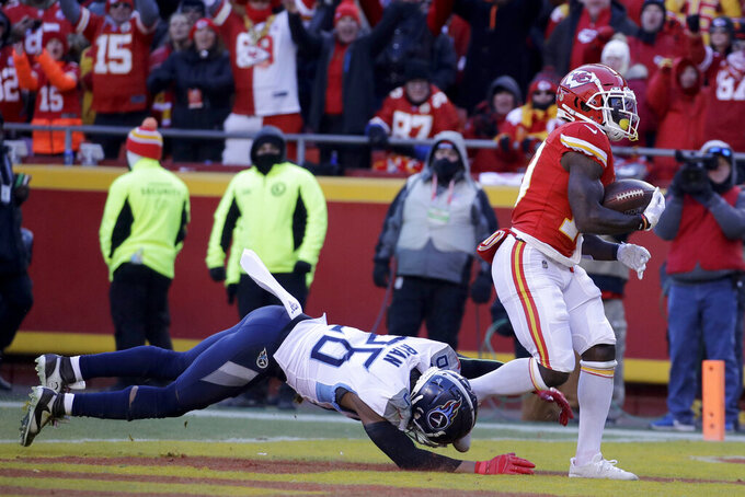 Kansas City Chiefs' Tyreek Hill catches a touchdown pass in front of Tennessee Titans' Logan Ryan (26) during the first half of the NFL AFC Championship football game Sunday, Jan. 19, 2020, in Kansas City, MO. (AP Photo/Charlie Riedel)