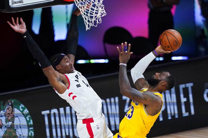 Los Angeles Lakers' LeBron James (23) shoots against Toronto Raptors' Rondae Hollis-Jefferson (4) during the second half of an NBA basketball game Saturday, Aug. 1, 2020, in Lake Buena Vista, Fla. (AP Photo/Ashley Landis, Pool)