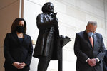 Standing near a statue of Frederick Douglass, Sen. Kamala Harris, D-Calif., left, and Senate Minority Leader Sen. Chuck Schumer of N.Y., right, pause during a prayer Capitol Hill in Washington, Thursday, June 4, 2020, during an event to commemorate the life of George Floyd, who died after being restrained by Minneapolis police officers. (AP Photo/Susan Walsh)