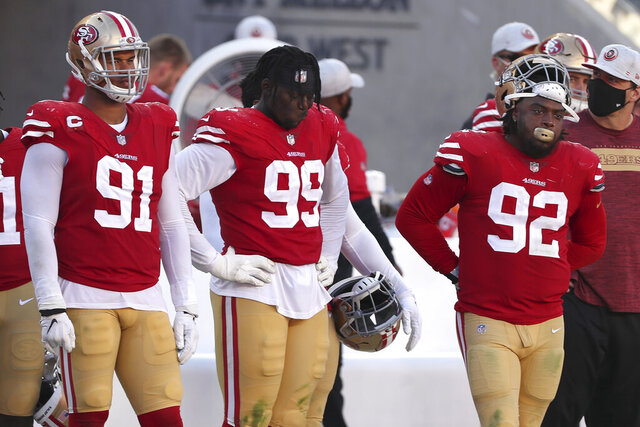San Francisco 49ers defensive end Arik Armstead (91), defensive tackle Javon Kinlaw (99) and defensive end Kerry Hyder Jr. (92) stand on the sideline during the second half of an NFL football game against the Miami Dolphins in Santa Clara, Calif., Sunday, Oct. 11, 2020. (AP Photo/Jed Jacobsohn)