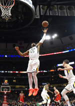 Utah Jazz guard Donovan Mitchell (45) grabs a rebound against the Chicago Bulls during the first half of an NBA basketball game Saturday, March 23, 2019, in Chicago. (AP Photo/David Banks)
