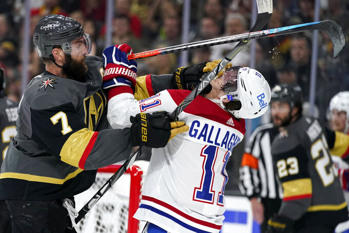 Vegas Golden Knights defenseman Alex Pietrangelo (7) and Montreal Canadiens right wing Brendan Gallagher (11) tussle during the first period in Game 5 of an NHL hockey Stanley Cup semifinal playoff series Tuesday, June 22, 2021, in Las Vegas. (AP Photo/John Locher)