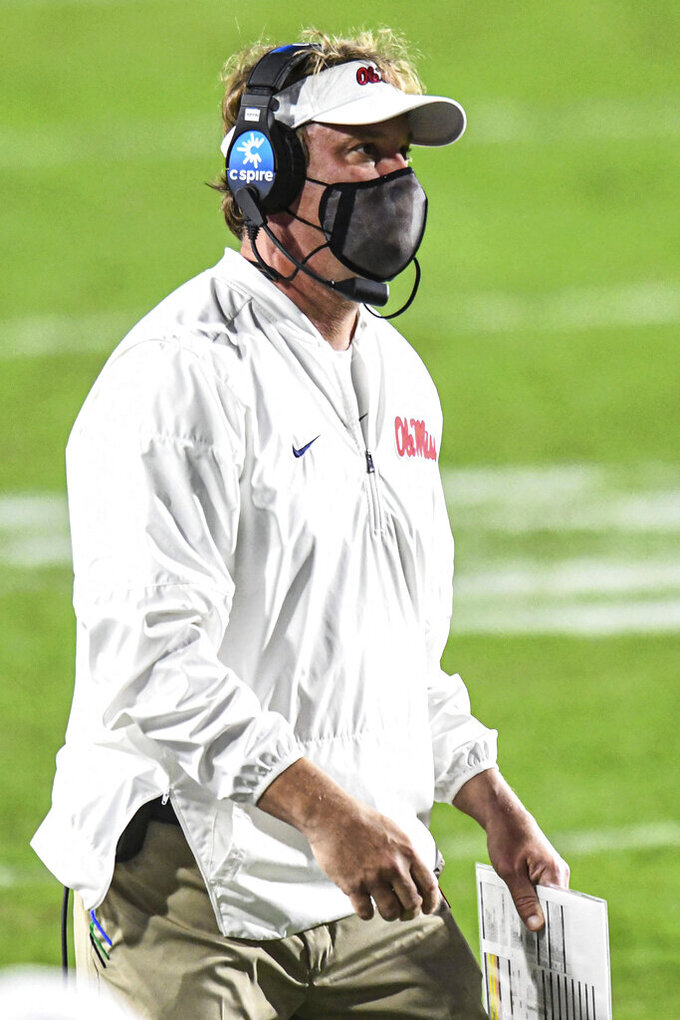 Mississippi coach Lane Kiffin watches the team play South Carolina during the first half of an NCAA college football game in Oxford, Miss., Saturday, Nov. 14, 2020. (AP Photo/Bruce Newman)