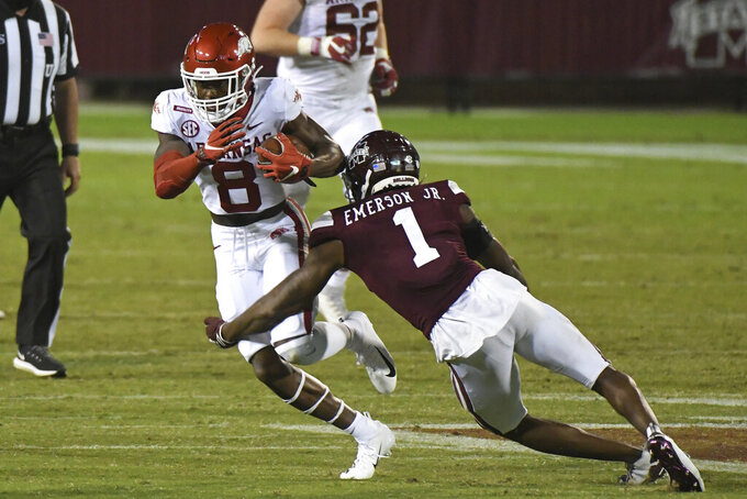 Mississippi State cornerback Martin Emerson (1) tackles Arkansas wide receiver Mike Woods (8) during the second half of an NCAA college football game in Starkville, Miss., Saturday, Oct. 3, 2020. Arkansas won 21-14. (AP Photo/Thomas Graning)