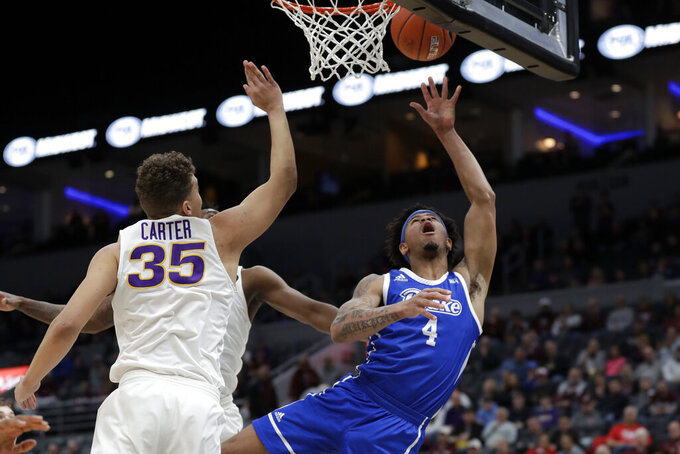 Drake's Anthony Murphy (4) heads to the basket past Northern Iowa's Noah Carter (35) during the first half of an NCAA college basketball game in the quarterfinal round of the Missouri Valley Conference men's tournament Friday, March 6, 2020, in St. Louis. (AP Photo/Jeff Roberson)