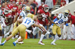 Oklahoma cornerback Tre Brown (6) takes a kickoff return for 86 yards past UCLA kicker J.J. Molson (17), Shea Pitts (47) defensive back Jay Shaw (24) in the first quarter of an NCAA college football game in Norman, Okla., Saturday, Sept. 8, 2018. (AP Photo/Sue Ogrocki)