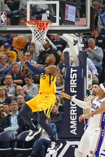 Utah Jazz guard Donovan Mitchell (45) lays the ball up as Philadelphia 76ers' Tobias Harris, front right, and Furkan Korkmaz watch during the second half during an NBA basketball game Wednesday, Nov. 6, 2019, in Salt Lake City. (AP Photo/Rick Bowmer)