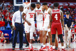 Massachusetts' Sy Chatman (1) is helped off the court by his teammates Jordy Tshimanga (32) and Ibi Watson (2) after an apparent injury during the second half of an NCAA college basketball game against Massachusetts, Saturday, Jan. 11, 2020, in Dayton. (AP Photo/John Minchillo)