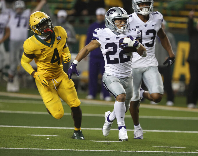 Kansas State running back Kaelen Shankle, centef, scores past Baylor safety Christian Morgan, left, during the second half of an NCAA college football game Saturday, Nov. 28, 2020, in Waco, Texas. (Rod Aydelotte/Waco Tribune Herald via AP)