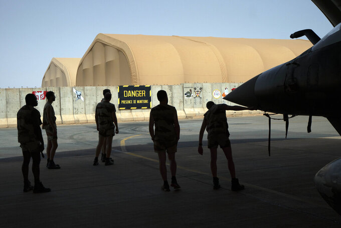 French Barkhane Air Force mechanics maintain a Mirage 2000 on the Niamey, Niger base June 5, 2021. French President Emmanuel Macron announced at a press conference Thursday June 10, 2021 That operation Barkhane would end and be replaced by support for local partners and counter terrorism. (AP Photo/Jerome Delay)