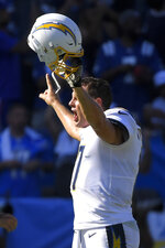 Los Angeles Chargers quarterback Philip Rivers celebrates after their overtime win against the Indianapolis Colts in an NFL football game Sunday, Sept. 8, 2019, in Carson, Calif. (AP Photo/Mark J. Terrill)