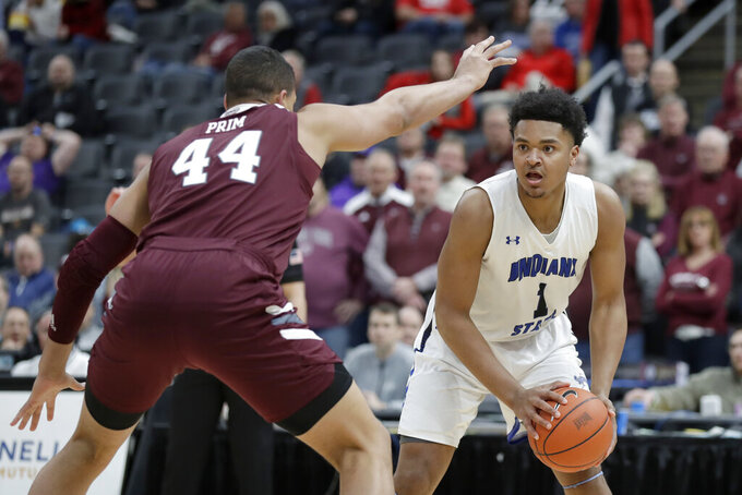 Indiana State's Tre Williams (1) looks to pass around Missouri State's Gaige Prim (44) during the first half of an NCAA college basketball game in the quarterfinal round of the Missouri Valley Conference men's tournament Friday, March 6, 2020, in St. Louis. (AP Photo/Jeff Roberson)