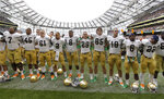 FILE - In this Sept. 1, 2012, file photo, Notre Dame players pose after the final whistle of their NCAA college football game against Navy, in Dublin, Ireland. The NCAA has denied Notre Dame's appeal of a decision to vacate 21 victories because of academic misconduct, including all 12 wins from the school's 2012 national championship game run. (AP Photo/Peter Morrison, File)