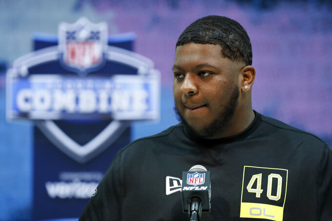 FILE - In this Feb. 26, 2020, file photo, Michigan offensive lineman Cesar Ruiz speaks during a press conference at the NFL football scouting combine in Indianapolis. Ruiz is a possible pick in the NFL Draft which runs Thursday, April 23, 2020, thru Saturday, April 25. (AP Photo/Charlie Neibergall, File)