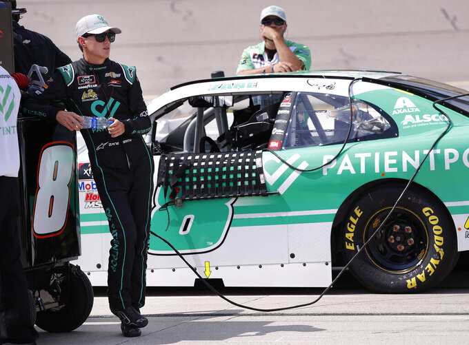Zane Smith waits during qualifying for the NASCAR Xfinity Series auto race, Saturday, July 27, 2019, at Iowa Speedway in Newton, Iowa. (AP Photo/Matthew Putney)