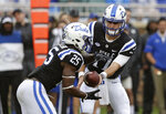 Duke quarterback Daniel Jones hands off to running back Deon Jackson (25) during the first half of an NCAA college football game against Virginia in Durham, N.C., Saturday, Oct. 20, 2018. (AP Photo/Gerry Broome)