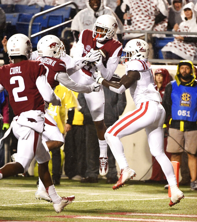 Arkansas defensive back Ryan Pulley intercepts a pass intended for Mississippi receiver A.J. Brown in the first half of an NCAA college football game Saturday, Oct. 13, 2018, in Little Rock, Ark. (AP Photo/Michael Woods)