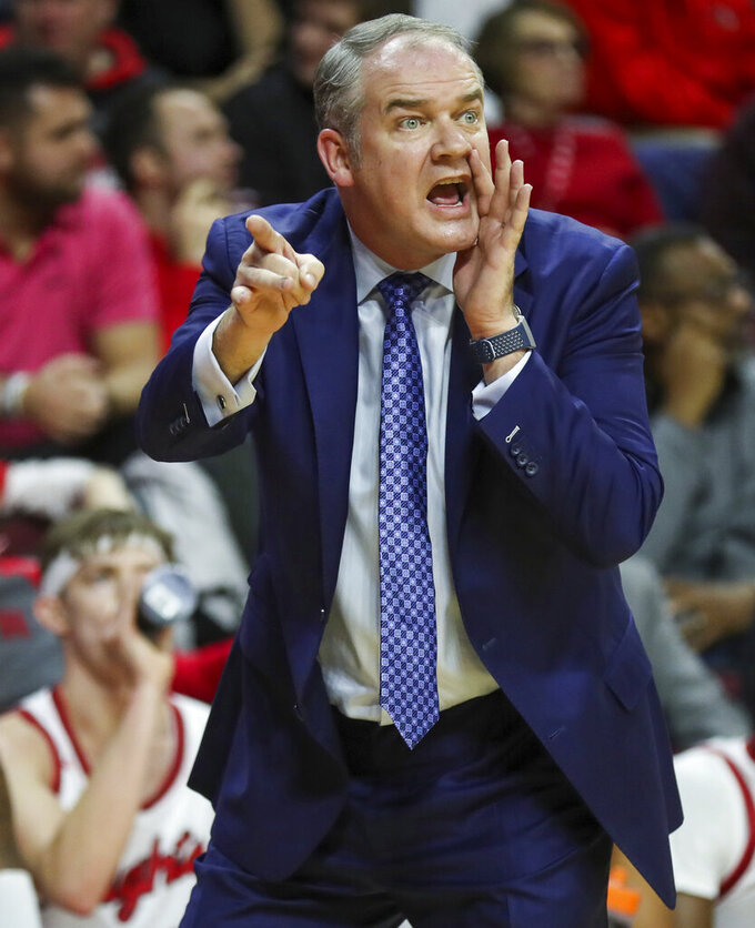 Rutgers coach Steve Pikiell works from the sideline during the first half of an NCAA college basketball game against Wisconsin in Piscataway, N.J., Wednesday, Dec. 11, 2019. (Andrew Mills/NJ Advance Media via AP)