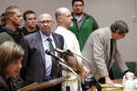 Curtis Watson, center, stands as a preliminary hearing is recessed Wednesday, Nov. 20, 2019, in Ripley, Tenn. Watson is charged with murdering Tennessee Department of Correction department administrator Debra Johnson after Watson escaped from the West Tennessee State Penitentiary in August. (AP Photo/Mark Humphrey, Pool)