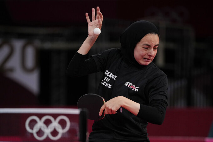Egypt's Dina Meshref blocks the ball hit by Poland's Natalia Partyka during the table tennis women's singles second round match against at the 2020 Summer Olympics, Sunday, July 25, 2021, in Tokyo. (AP Photo/Kin Cheung)