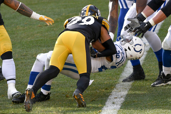 Indianapolis Colts running back Jonathan Taylor (28) gets over the goal past Pittsburgh Steelers free safety Minkah Fitzpatrick (39) for a touchdown during the first half of an NFL football game, Sunday, Dec. 27, 2020, in Pittsburgh. (AP Photo/Don Wright)