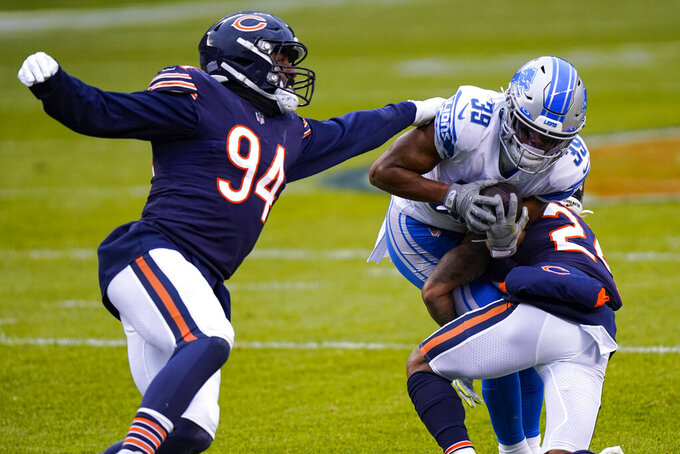 Detroit Lions wide receiver Jamal Agnew (39) is tackled by Chicago Bears cornerback Buster Skrine (24) and linebacker Robert Quinn (94) in the first half of an NFL football game in Chicago, Sunday, Dec. 6, 2020. (AP Photo/Nam Y. Huh)