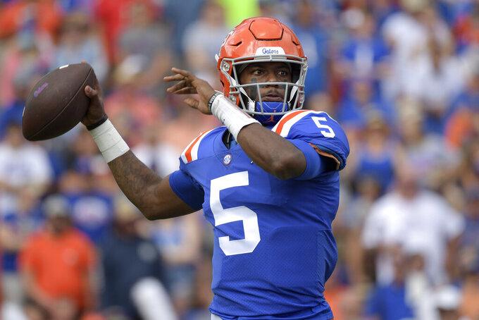Florida quarterback Emory Jones (5) throws a pass during the first half of an NCAA college football game against Vanderbilt, Saturday, Oct. 9, 2021, in Gainesville, Fla. (AP Photo/Phelan M. Ebenhack)