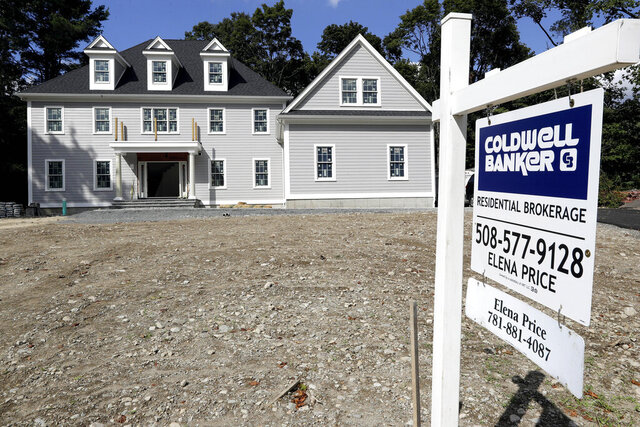 FILE - In this Sept. 3, 2019 file photo a sign rests in front of a newly constructed home, in Westwood, Mass. Long-term U.S. mortgage were unchanged this week as the benchmark 30-year home loan remains at a its lowest rate in nearly 50 years. Mortgage buyer Freddie Mac reported Thursday, June 25, 2020 that the average rate on the key 30-year loan stood at 3.13%. (AP Photo/Steven Senne, File)