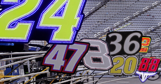 Team car numbers hang out over pit lane prior to a NASCAR Cup Series auto race at New Hampshire Motor Speedway in Loudon, N.H., Sunday, July 21, 2019. (AP Photo/Charles Krupa)
