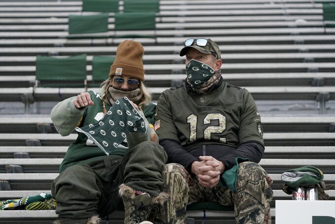 Packers fans watch warm ups before the NFC championship NFL football game between the Tampa Bay Buccaneers and Green Bay Packers in Green Bay, Wis., Sunday, Jan. 24, 2021. (AP Photo/Morry Gash)