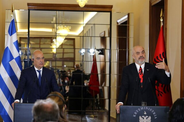 Albanian Prime Minister Edi Rama, right, makes a statement with the Greek Foreign Minister Nikos Dendias after their meeting in Tirana, Tuesday, Oct. 20, 2020. Bilateral issues and maritime border delimitation in the Ionian Sea were the main topics of their discussion. (AP Photo/Hektor Pustina)