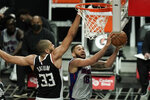 Detroit Pistons' Cory Joseph, right, goes up for a basket against Los Angeles Clippers' Nicolas Batum during the first half of an NBA basketball game Sunday, April 11, 2021, in Los Angeles. (AP Photo/Jae C. Hong)