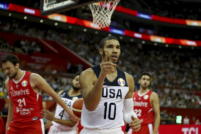 United States' Jayson Tatum reacts after scoring against Turkey for the FIBA Basketball World Cup at the Shanghai Oriental Sports Center in Shanghai on Tuesday, Sept. 3, 2019. The United States beat Turkey 93:92.(AP Photo/Ng Han Guan)