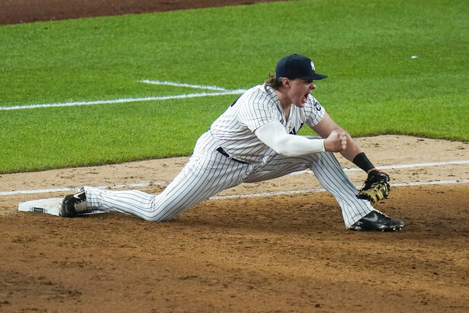 CORRECTS TO TRIPLE PLAY, INSTEAD OF DOUBLE PLAY - New York Yankees' Luke Voit celebrates after Chicago White Sox's Andrew Vaughn was thrown out at first base to complete a triple play during the ninth inning of a baseball game Friday, May 21, 2021, in New York. (AP Photo/Frank Franklin II)