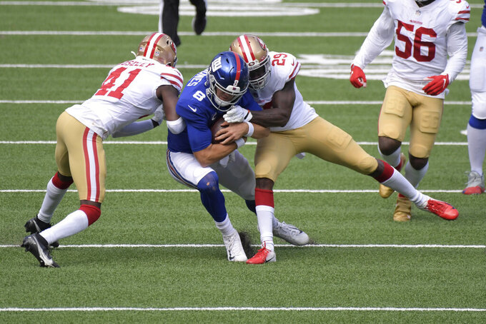 San Francisco 49ers defenders tackle New York Giants quarterback Daniel Jones (8) during the first half of an NFL football game, Sunday, Sept. 27, 2020, in East Rutherford, N.J. (AP Photo/Bill Kostroun)