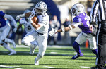 Monmouth running back Pete Guerriero (25) escapes from James Madison safety D'Angelo Amos (24) during the first half of a second-round game in the NCAA Football Championship Subdivision playoffs Saturday, Dec. 7, 2019, in Harrisonburg, Va. (Daniel Lin/Daily News-Record via AP)