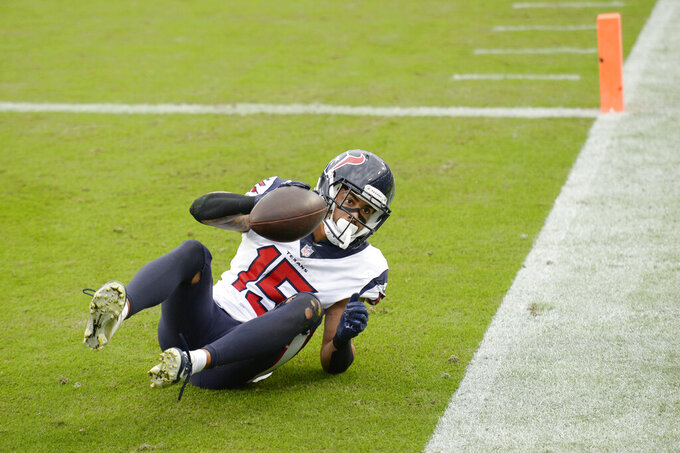 Houston Texans wide receiver Will Fuller catches a touchdown pass against the Tennessee Titans in the second half of an NFL football game Sunday, Oct. 18, 2020, in Nashville, Tenn. (AP Photo/Mark Zaleski)