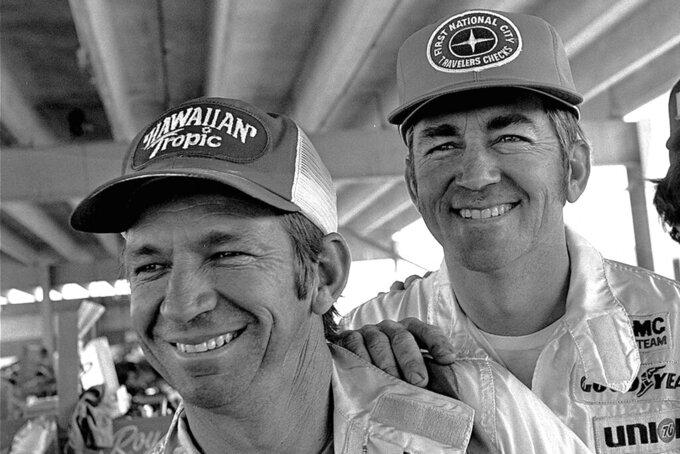 FILE - Donnie Allison , left, and Bobby Allison smile in Talladega, Ala., in this April 29, 1977, file photo.  The Busch brothers are moving up on the Allisons on NASCAR's all-time wins list for siblings.(AP Photo/Joe Holloway, Jr., File)