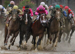 FILE - In this May 4, 2019, file photo, Flavien Prat on Country House, left, races against Luis Saez on Maximum Security, third from left, during the 145th running of the Kentucky Derby horse race at Churchill Downs in Louisville, Ky. Kentucky Derby winner Country House will not run in the Preakness. Assistant trainer Riley Mott confirmed to The Associated Press on Tuesday, May 7 that the longshot winner of horse racing's biggest event is no longer being considered for the second jewel of the Triple Crown. Country House was named the winner of the Kentucky Derby after Maximum Security was disqualified. (AP Photo/John Minchillo, File)