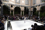 A model wears a creation as part of the Armani Spring-Summer 2020 collection, unveiled during the fashion week, in Milan, Italy, Saturday, Sept. 21, 2019. (AP Photo/Luca Bruno)