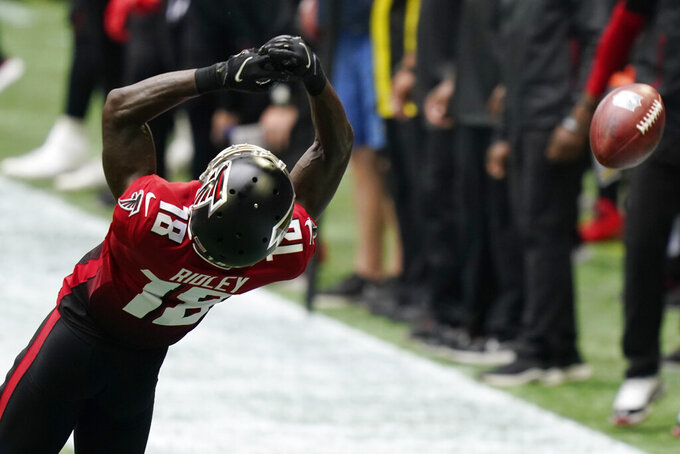 Atlanta Falcons wide receiver Calvin Ridley (18) misses the catch against the Detroit Lions during the first half of an NFL football game, Sunday, Oct. 25, 2020, in Atlanta. (AP Photo/Brynn Anderson)