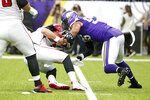 Atlanta Falcons quarterback Matt Ryan is sacked by Minnesota Vikings outside linebacker Anthony Barr, right, during the first half of an NFL football game, Sunday, Sept. 8, 2019, in Minneapolis. (AP Photo/Bruce Kluckhohn)