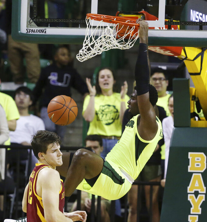 Baylor guard Mario Kegler, right, dunks over Iowa State forward Michael Jacobson during the first half of an NCAA college basketball game Tuesday, Jan. 8, 2019, in Waco, Texas. (AP Photo/Rod Aydelotte)