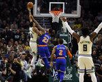 Milwaukee Bucks' Giannis Antetounmpo shoots against New York Knicks' Mitchell Robinson (23) during the first half of an NBA basketball game Monday, Dec. 2, 2019, in Milwaukee. (AP Photo/Jeffrey Phelps)