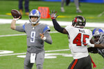 Detroit Lions quarterback Matthew Stafford (9) throws during the first half of an NFL football game against the Tampa Bay Buccaneers, Saturday, Dec. 26, 2020, in Detroit. (AP Photo/Al Goldis)